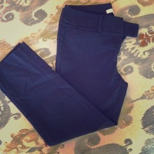 The Loft navy ankle-length business pant.